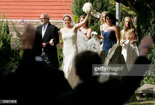 Amanda Kline waves to other guests as she arrives at St Edmund's Church for her wedding to Mark Dyer on July 3 2010 in Abergavenny Wales