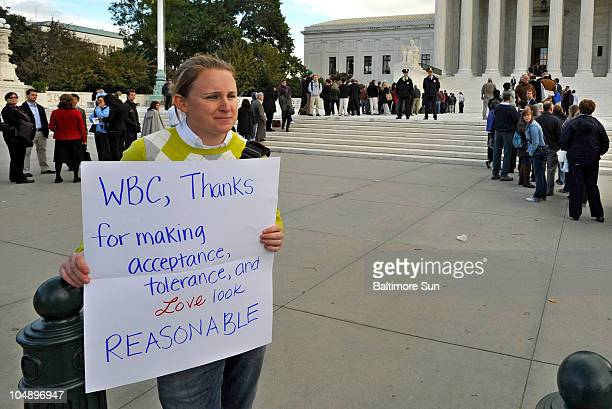Amanda Klinger of Washington, D.C., offered a counterpoint to the protest signs displayed by the Westboro Baptist Church group outside the U.S....
