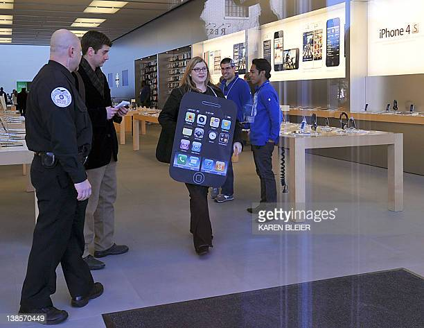 Amanda Kloer Director of Organizing at Campaign on Changeorg leaves the Apple store during a protest in front of the Apple store in Washington DC on...