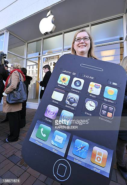 Amanda Kloer Director of Organizing at Campaign on Changeorg seen wearing an iPhone placard during a protest in front of the Apple store in...