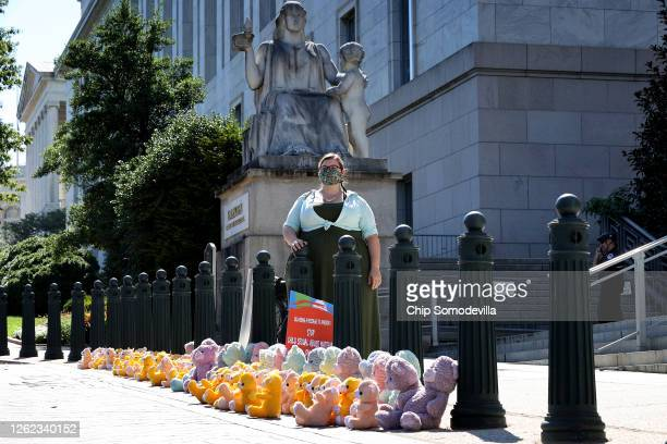 Amanda Kloer of ParentsTogether poses after setting up a 'teddy bear sit in' in front of the Rayburn House Office Building July 29, 2020 in...