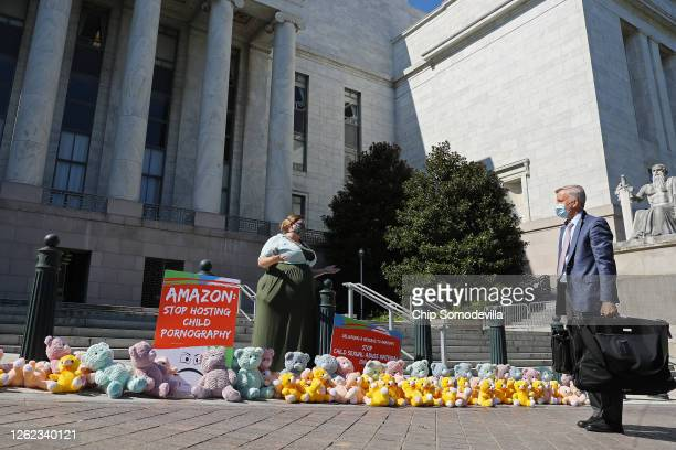 Amanda Kloer of ParentsTogether talks with Rep. Chris Jacobs during a 'teddy bear sit in' in front of the Rayburn House Office Building July 29, 2020...