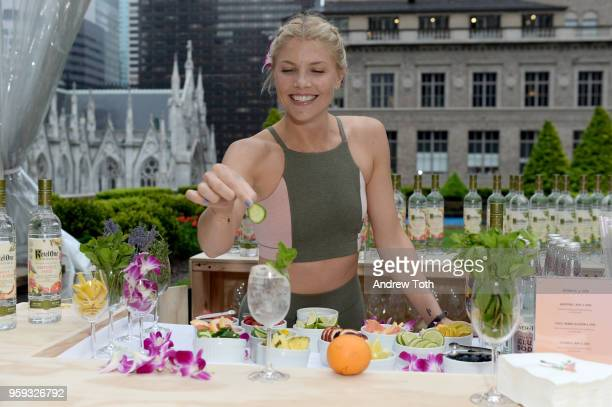 Amanda Kloots garnishes her Botanical and Soda with Cucumber and Mint at the Launch of Ketel One Botanical on May 16 2018 in New York City