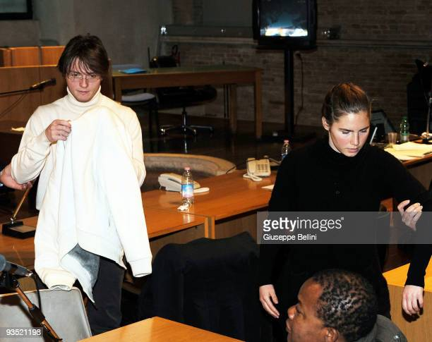 Amanda Knox and Raffaele Sollecito take their seats as they attend the Meredith Kercher murder trial for the closing arguments on December 01, 2009...