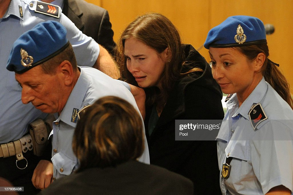 Amanda Knox breaks down in tears after hearing the verdict that overturns her conviction and acquits her of murdering her British roommate Meredith Kercher at the Perugia court on October 3, 2011 in Perugia, Italy. American student Amanda Knox and her Italian ex-boyfriend Raffaele Sollecito have won their appeal against their conviction in 2009 of killing their British roommate Meredith Kercher in Perugia, Italy in 2007. The pair had served nearly four years in jail after initially being sentenced to 26 and 25 years respectively.