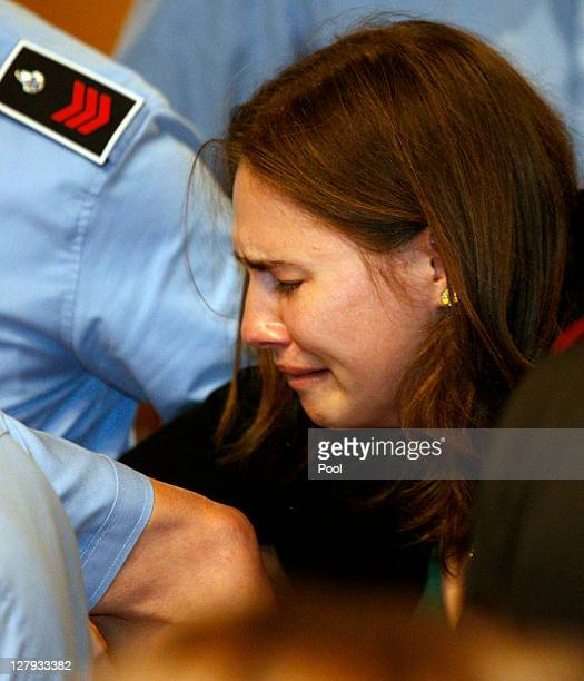 Amanda Knox breaks down in tears as she is taken away after hearing the verdict that overturns her conviction and acquits her of murdering her...