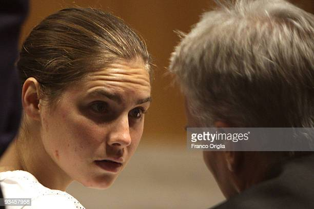 Amanda Knox chats with her lawyer during the lawyer defense closing speech of the Meredith Kercher murder trial at the Perugia courthouse on November...