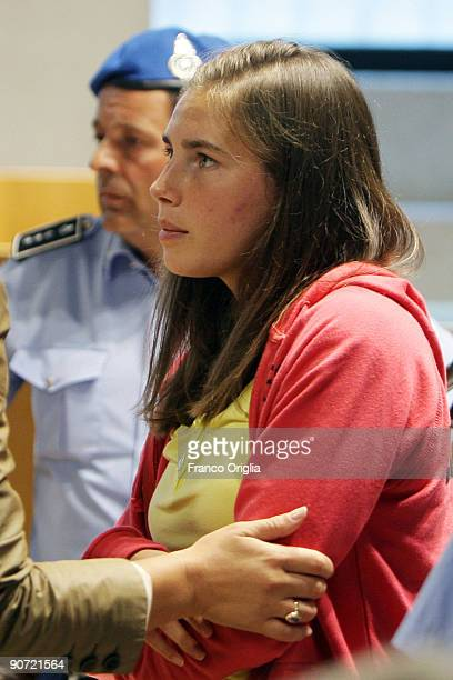 Amanda Knox chats with her lawyer's assistant during the sitting of the Meredith Kercher murder trial at the Perugia courthouse on September 14 2009...