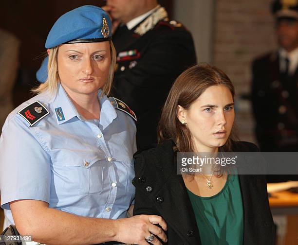 Amanda Knox enters Perugia's Court of Appeal to learn that she won her appeal against her murder conviction on October 3, 2011 in Perugia, Italy....