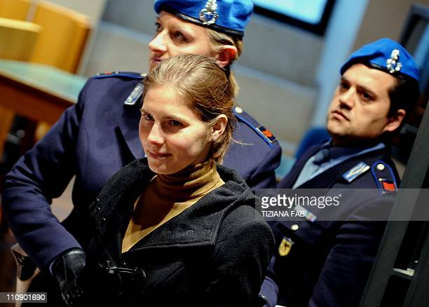 US Amanda Knox is escorted by police as she arrives in court before the start of a session of her appeal trial in Perugia's courthouse on March 26...