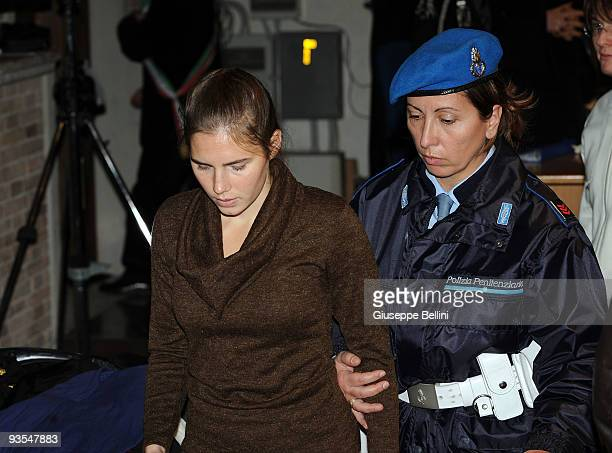 Amanda Knox is escorted by police officers at the courthouse while attending the Meredith Kercher Trial for the closing arguments on December 2, 2009...