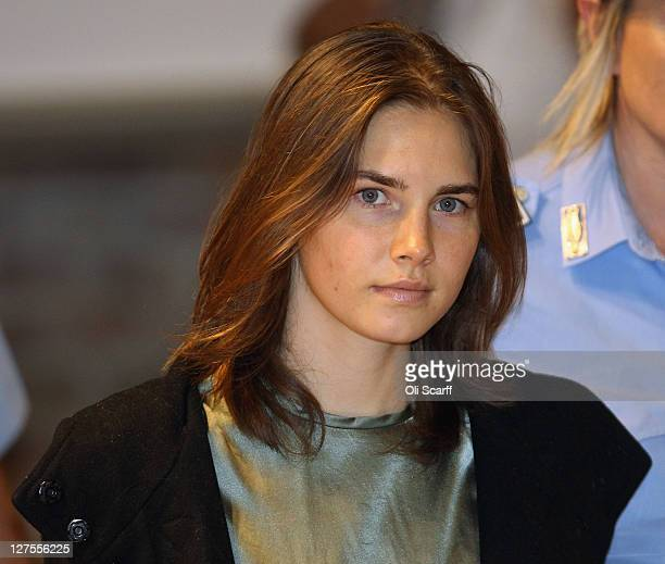 Amanda Knox is escorted to her appeal hearing at Perugia's Court of Appeal on September 29, 2011 in Perugia, Italy. Amanda Knox and Raffaele...