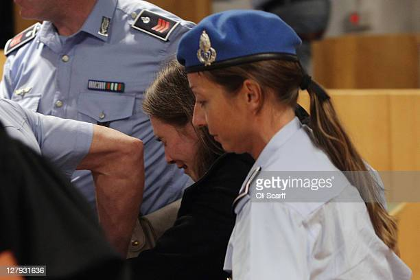 Amanda Knox leaves Perugia's Court of Appeal in tears after learning that she won her appeal against her murder conviction on October 3, 2011 in...