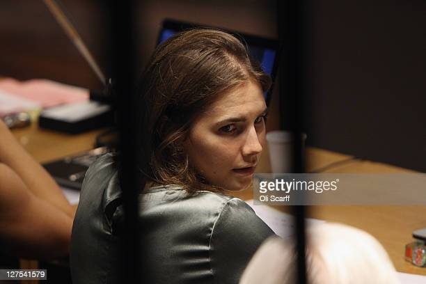 Amanda Knox looks at her lawyer Luciano Ghirga as she attends her appeal hearing at Perugia's Court of Appeal on September 29, 2011 in Perugia,...
