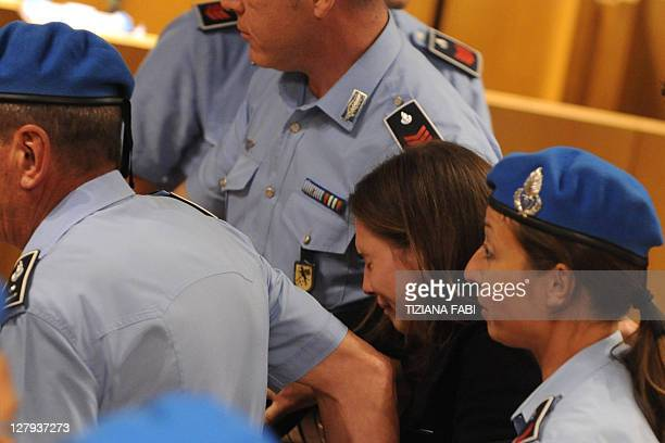 US Amanda Knox reacts as she leaves after the verdict of her appeal trial in the Meredith Kercher' murder on October 3 2011at Perugia's court...