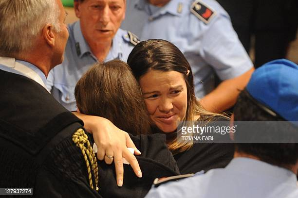 US Amanda Knox reacts with lawyers upon the verdict of her appeal trial in the Meredith Kercher' murder on October 3 2011at Perugia's court American...