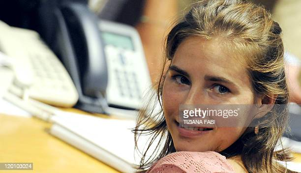 US Amanda Knox smiles during a session of her appeal trial in Perugia's courthouse on July 30 2011 A forensic expert in Amanda Knox's appeal against...