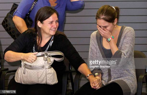 Amanda Knox sobs after hearing the cheers of supporters while her mother Edda Mellas comforts her on October 4 2011 in Seattle Washington American...