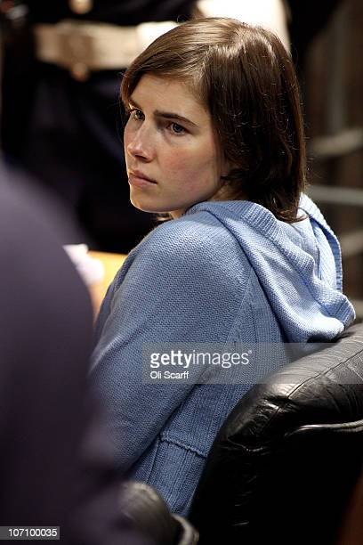 Amanda Knox speaks to her legal team in Perugia's court of Appeal during the first session of her appeal against her murder conviction on November 24...