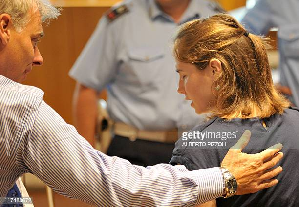 US Amanda Knox talks with her lawyer Carlo Della Vedova as she takes place in court at the start of a session of her appeal trial in Perugia's...