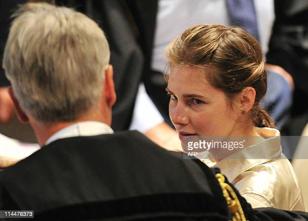US Amanda Knox who was convicted for the murder of a British student in Italy looks on before the start of her appeal hearing at the courthouse in...