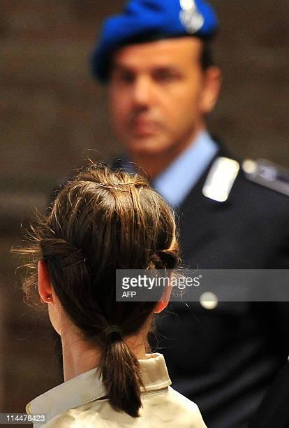US Amanda Knox who was convicted for the murder of a British student in Italy stands before the start of her appeal hearing at the courthouse in...