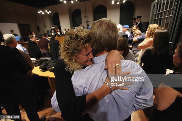 Amanda Knox's father Curt Knox is hugged by his wife Cassandra Knox in Perugia's Court of Appeal after hearing that his daughter won her appeal...