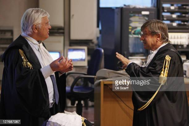 Amanda Knox's lawyer Luciano Ghirga and public prosecutor Giancarlo Costagliola chat in Perugia's Court of Appeal on September 30 2011 in Perugia...