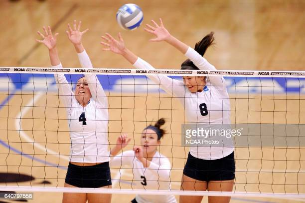 Amanda Konetchy and Katie Habeck of Concordia University St Paul jump for a block against Cal State San Bernardino during the Division II Women's...