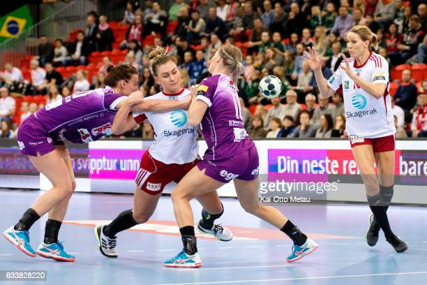 Amanda Kurtovic pass the ball to Gro HammersengEdin as Trine Ostergaard Jensen and Veronica Kristiansen tries to block in the game between Larvik HK...