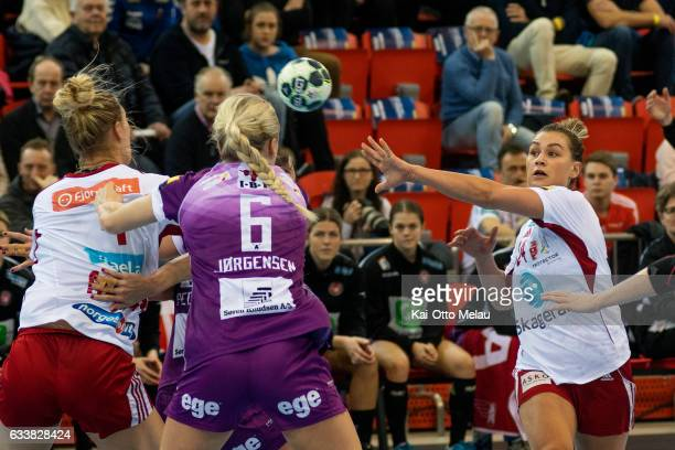 Amanda Kurtovic pass the ball to Marit Malm Frafjord as Stine Joergensen tries to block in the game between Larvik HK and FC Midtjylland on February...