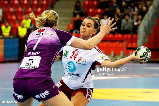 Amanda Kurtovic shoots as Linn Blohm tries to block in the game between Larvik HK and FC Midtjylland on February 4 2017 in Larvik Norway