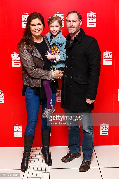 """Amanda Lamb and Sean McGuinness attend a photocall for Disney's """"Big Hero 6"""" at Odeon Leicester Square on January 18, 2015 in London, England."""