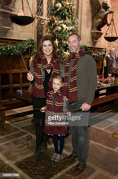 Amanda Lamb, Sean McGuinness and daughter Willow attend the Launch Of Hogwarts In The Snow at Warner Bros. Studio Tour London on November 12, 2015 in...