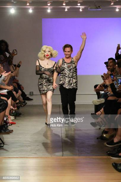 Amanda Lapore and designer Michael Kuluva walk the runway at the Tumbler And Tipsy by Michael Kuluva Spring/Summer 2015 fashion show during New York...