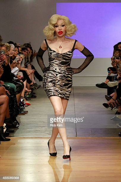 Amanda Lapore walks the runway at the Tumbler And Tipsy by Michael Kuluva Spring/Summer 2015 fashion show during New York Fashion Week on September 9...