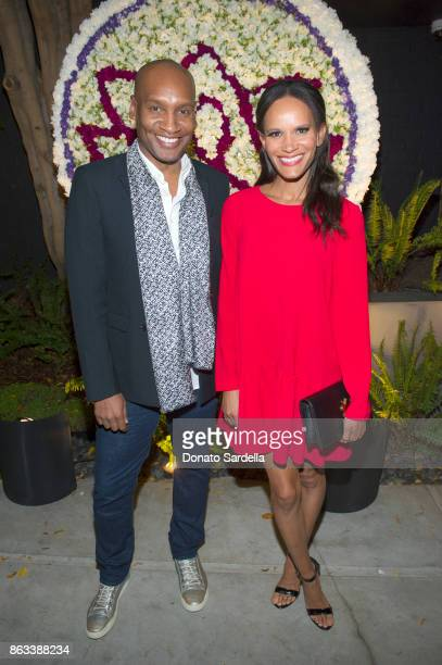 Amanda Latrell Garigas and Marcellas Reynolds at Living Beauty 'The Gift' Photo Exhibit at The Buterbaugh Gallery on October 19 2017 in Los Angeles...