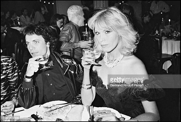 Amanda Lear and her friend AlainPhilippe Malagnac attend a 'Femme Fatale' theme party at the 'Palace' night club in Paris in 1980
