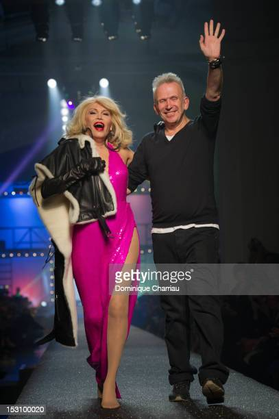 Amanda Lear and Jean-Paul Gaultier walk the runway after the Jean-Paul Gaultier Spring / Summer 2013 show as part of Paris Fashion Week on September...