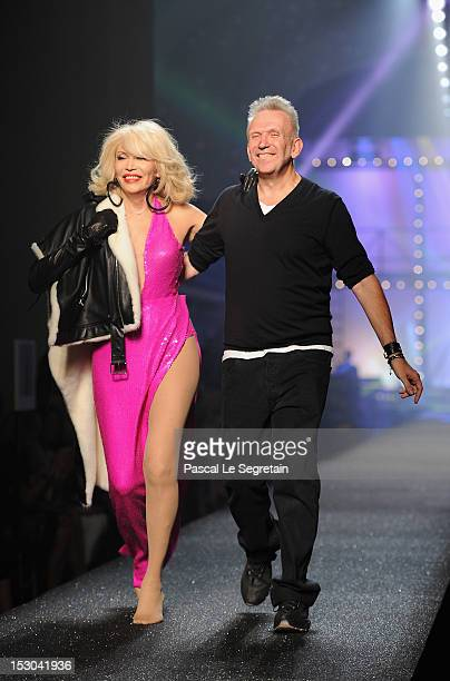 Amanda Lear and JeanPaul Gaultier walk the runway during the JeanPaul Gaultier Spring / Summer 2013 show as part of Paris Fashion Week on September...