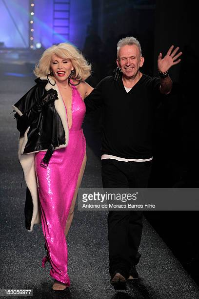 Amanda Lear and Jean-Paul Gaultier walk the runway during the Jean-Paul Gaultier Spring / Summer 2013 show as part of Paris Fashion Week on September...