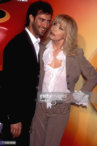 Amanda Lear and Manuel Casella during 'The Incredibles' Paris Premiere at Grand Rex in Paris France