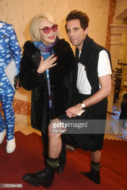 Amanda Lear and Mika attend the JeanPaul Gaultier Haute Couture Spring/Summer 2020 show as part of Paris Fashion Week at Theatre Du Chatelet on...