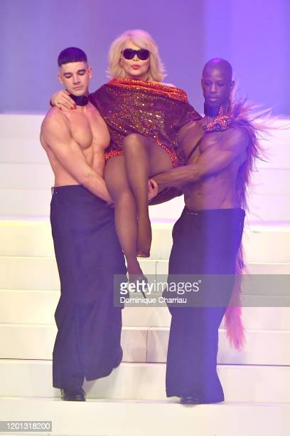 Amanda Lear and models walk the runway during the JeanPaul Gaultier Haute Couture Spring/Summer 2020 show as part of Paris Fashion Week at Theatre Du...