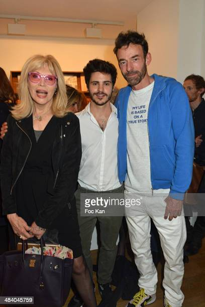 Amanda Lear Matthieu Charneau and Alain Gossuin attend the 'Heros' Pierre et Gilles Exhibition At Galerie Templon on April 10 2014 in Paris France