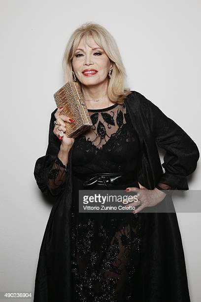 Amanda Lear poses at amfAR Milano 2015 at La Permanente on September 26 2015 in Milan Italy