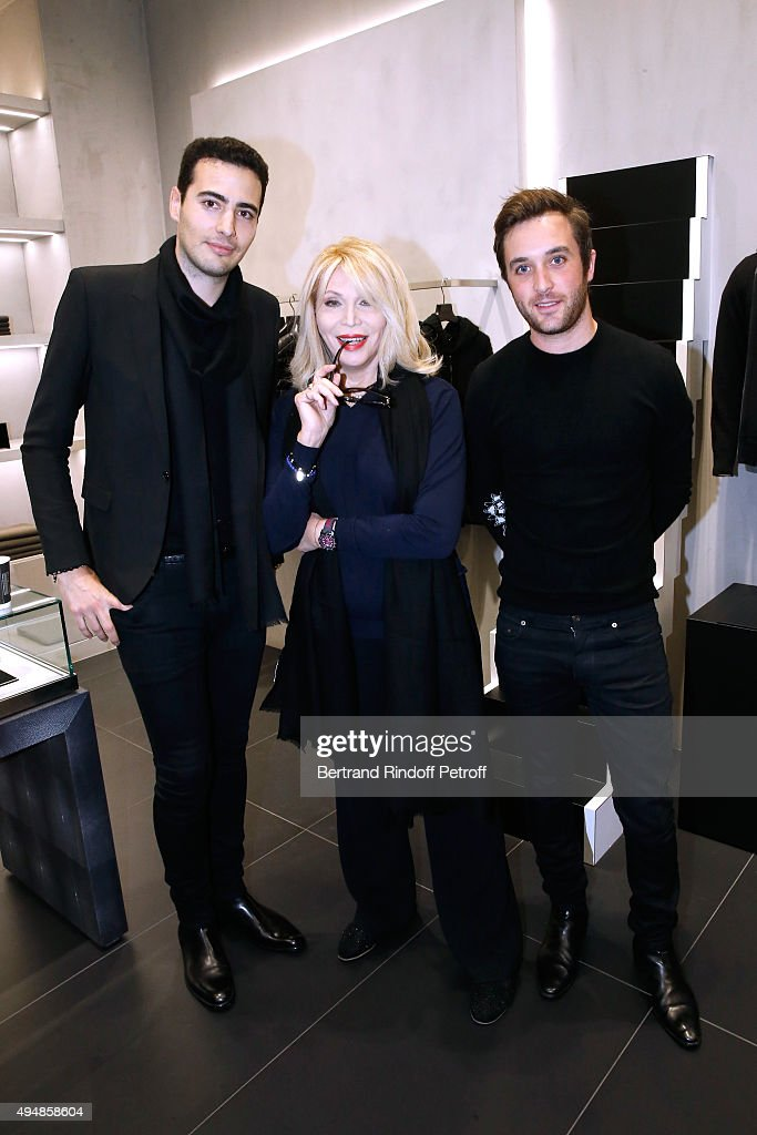 Amanda Lear standing between Co-Founders of the Store, Louis Leboiteux (R) and Jean-Victor Meyers (L) attend the Opening of the Collection 'Exemplaire x Nicolas Ouchenir' at Exemplaire Store on October 29, 2015 in Paris, France.