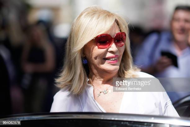 Amanda Lear wears red sunglasses and a white shirt outside JeanPaul Gaultier during Paris Fashion Week Haute Couture Fall Winter 2018/2019 on July 4...