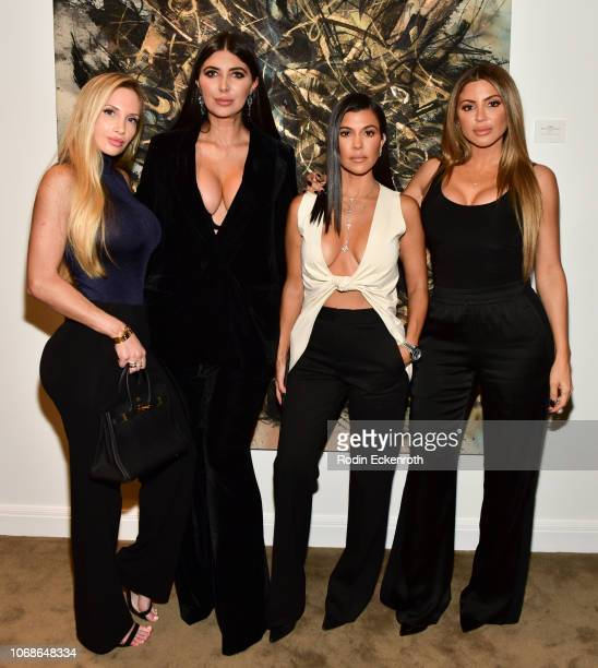 Amanda Lee Brittny Gastineau Kourtney Kardashian and Larsa Pippen pose for portrait at the VIP Exhibit Preview for 'Street Dreams' on November 16...