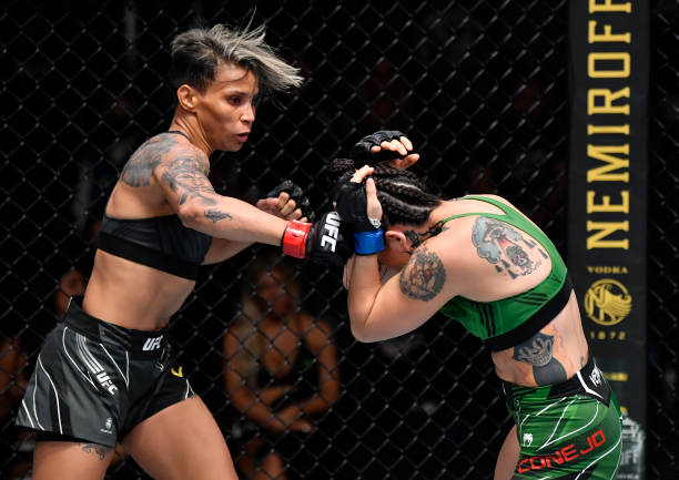 Amanda Lemos of Brazil punches Montserrat Conejo of Mexico in their strawweight bout during the UFC Fight Night event at UFC APEX on July 17, 2021 in...